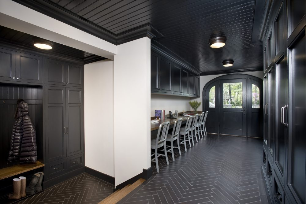 Photo of a Mudroom with strong black accents