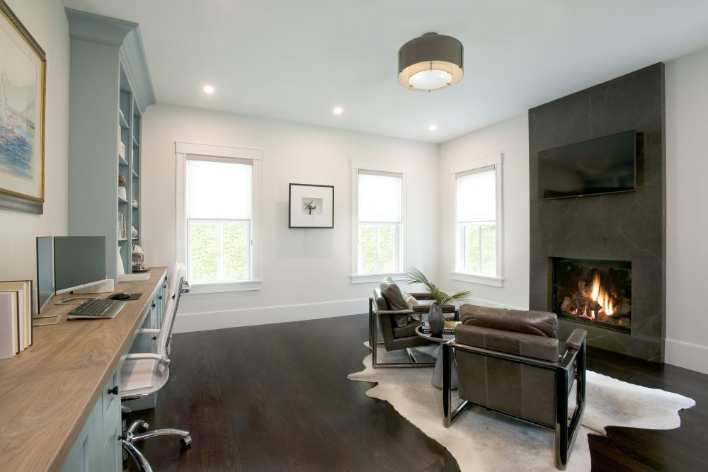 Cozy office with a fireplace and built-in shelves